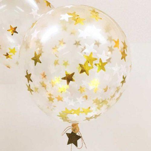 Confetti-ilmapallosetti sisältää kaiken tarvittavan, jotta saat lastenjuhliin näyttäviä, kimmeltäviä kultatähtisiä ilmapalloja!