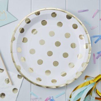 Kultapilkullinen pyöreä kertakäyttölautanen Näissä paperilautasissa on kultaisia pilkkuja valkoisella pohjalla ja lautasissa on kultaiset reunat. Lautaset tuovat juhlapöytään välittömästi tyylikästä tunnelmaa ja siivous sujuu helposti juhlien jälkeen!