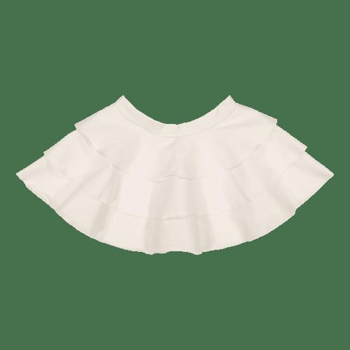 Gugguu Frilla hame, sävy White Sand Candy kokoelman tyttömäinen trikoohame, jossa ihanana yksityiskohtana kauniisti laskeutuva röyhelöhelma. Vyötäröllä on säädettävä kuminauhakiristys.
