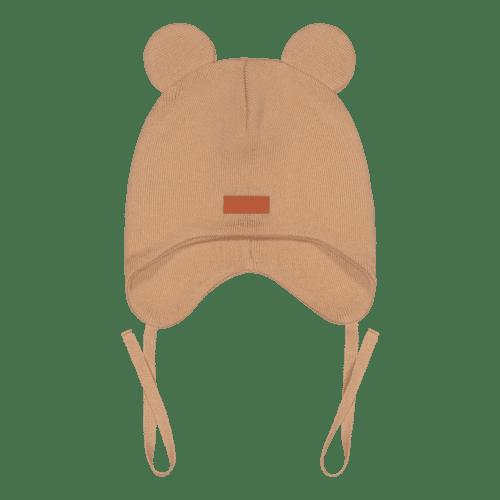 Gugguu Baby Bear vauvan nauhapipo nallekorvilla, sävy Sugar Cookie Yksinkertaisen tyylikäs nauhapipo on ommeltu pehmeästä ja joustavasta kankaasta. Luomupuuvillainen pipotuntuu mukavalta lapsen päässä eikä hankaa. Hyvin istuva pipo pysyy paikallaan valumatta silmille. Tämä pipomalli suojaa korvien lisäksi tehokkaasti myös vauvan poskia!