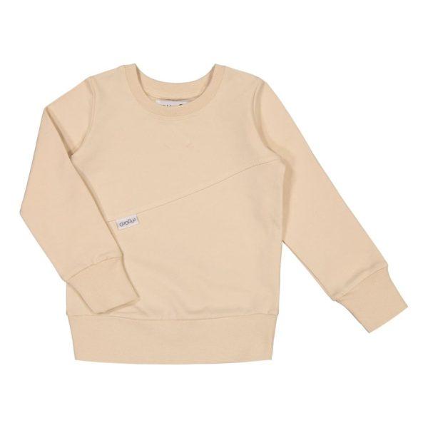 Gugguu Mono College paita, sävy Linen Beige Natural kokoelman tyylikäs pitkähihainen collegepaita, jossa kivana yksityiskohtana poikittainen leikkaus. Pääntiessä ja hihansuissa on resorit. Materiaali on todella mukavaa, pehmeää ja joustavaa, jotta lapsen on mukava liikkua.