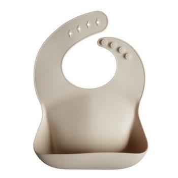Mushie vedenpitävä ruokalappuvauvalle, tyylikäs sävy Sand Pehmeästi muotoutuva ruokalappu on mukava päällä ja suojaa vauvan vaatteita ruokailun ajan. Silikonista valmistettu ruokasuoja on vedenkestävä, se hylkii likaa ja ruokasuojan voi huuhdella tai pestä puhtaaksi helposti saippualla. Ruokalapun takana on säädettävä kiinnitys, joten saat ruokalapun juuri sopivan kokoiseksi omalle vauvallesi.